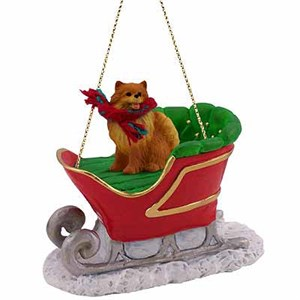 Pomeranian Sleigh Ride Christmas Ornament Red